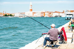 Fishing in Venice Royalty Free Stock Images