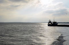 Fishing vessel along the Essex coastline. Royalty Free Stock Images