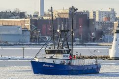 Fishing vessel Debbie Ann on icy river. New Bedford, Massachusetts, USA - January 9, 2018: Fishing vessel Debbie Ann, hailing port Point Judith, Rhode Island Royalty Free Stock Photos