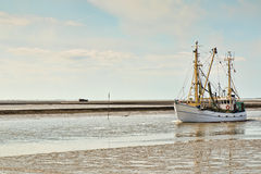 Fishing Vessel Entering Port Royalty Free Stock Photos