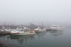Fishing vessel in a foggy misty morning Royalty Free Stock Photography