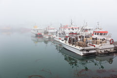 Fishing vessel in a foggy misty morning Stock Images