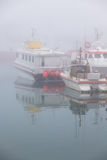 Fishing vessel in a foggy misty morning in Hofn, Iceland Stock Photography
