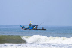 Fishing vessel goes to the sea Stock Photos