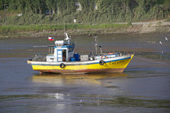 Fishing vessel on low tide, Chiloe Island, Chile Royalty Free Stock Photography