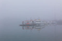 Fishing vessel in a misty morning at Harbor in Hofn, Iceland Royalty Free Stock Image