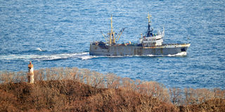 Fishing vessel returning to harbor Royalty Free Stock Image