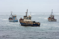 Fishing vessels during bad weather at sea Royalty Free Stock Photo