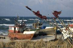 Fishing vessels on beach Royalty Free Stock Photography