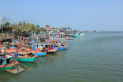 Fishing vessels. Fishing boats lined up along the coast in Thailand Stock Image