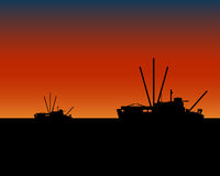 Fishing vessels boats at sunset Stock Photography