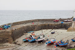 Fishing vessels in harbour at low tide Royalty Free Stock Images
