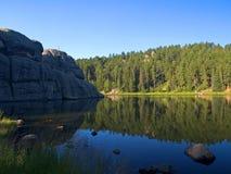 Fishing on a Vibrant Lake Stock Image