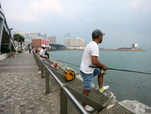 Fishing at Victoria Harbor, Hong Kong Royalty Free Stock Image