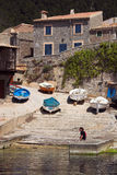 Fishing village A. Fishing village with boats and slipway viewed from across the habour Stock Image