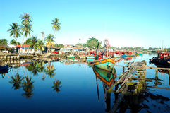 Fishing village. Scenery of a fishing village with beautiful reflection Stock Image