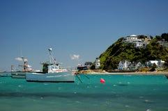 Fishing Village. Fishing boat at anchor near houses Stock Image