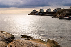 Fishing village. At the rocky coast Stock Photos