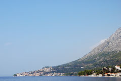 Fishing village. On the Adriatic coast, at the foot of a mountain Royalty Free Stock Photos