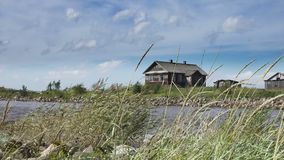 The fishing village on the bank of the North Sea, old boats of fishermen and wooden houses, Russia,Gulf of Finland stock video