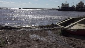 The fishing village on the bank of the North Sea, old boats of fishermen and wooden houses, Russia,Gulf of Finland stock footage