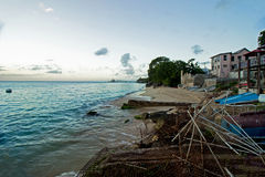 A Fishing village beach on Barbados North West Coast and the calm blue waters of the Caribbean Sea. Stock Photos