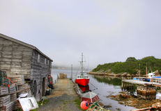 Fishing village with boat and boathouse Royalty Free Stock Images