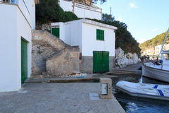 Fishing village Cala Figuera port with boathouses and green gates, Majorca Stock Images