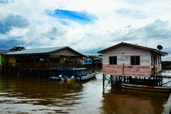 Fishing village and Cloudy sky. Fishing village in East Malaysia. Limpid water and Cloudy sky Stock Photography