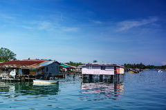 Fishing village and Cloudy sky. Fishing village in East Malaysia. Limpid water and Cloudy sky Royalty Free Stock Image