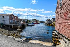 Fishing village cove with boats and fishing shacks Royalty Free Stock Images