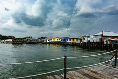 Fishing village. In East Malaysia. Clear water and Cloudy sky Stock Photos