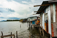 Fishing village. In East Malaysia. Clear water and Cloudy sky Royalty Free Stock Images