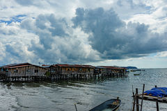 Fishing village. In East Malaysia. Clear water and Cloudy sky Royalty Free Stock Image