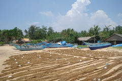 Fishing village and fishing nets on the shores Royalty Free Stock Photo