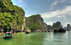 Fishing Village, Halong Bay, Vietnam. A photo of a fishing village in Halong Bay, Vietnam. In the backdrop, a series of limestone karst can be seen Royalty Free Stock Photo
