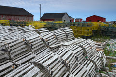 Fishing village and lobster traps. Pile of lobster traps in the fishing village in Newfoundland, Canada Stock Photos
