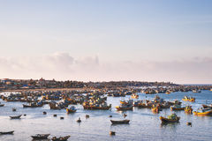 Fishing village, market and colorful fishing boats, Vietnam. Stock Photos