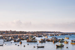 Fishing village, market and colorful traditional fishing boats Stock Images