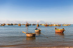 Fishing village, market and colorful traditional fishing boats Royalty Free Stock Photo