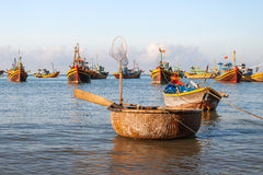 Fishing village, market and colorful traditional fishing boats Stock Image