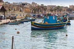 Fishing village Marsaxlokk, island Malta. Water of the mediterranean sea, bay and port in the fishing village Marsaxlokk at the island Malta. Colorful Royalty Free Stock Image