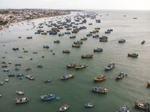 Fishing village in Mui Ne, Vietnam. A lot of old fishing boats in the poor fishing village of Vietnam. Top view. Aerial view royalty free stock photos