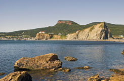Fishing village Perce in the Gaspesie. Quebec, Canada, viewed from Perce Rock at low tide Royalty Free Stock Image