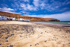 Fishing village Pozo Negro with stone and sand beach, Fuerteventura, Canary Island, Spain. Stock Images