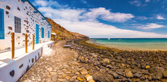 Fishing village Pozo Negro with stone and sandy beach on Fuerteventura, Canary Island, Spain. Royalty Free Stock Images