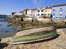 Fishing village, there is a boat in the foreground Stock Photography