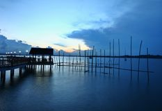 Asian Fishing village in twilight at Singapore Stock Image