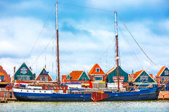 Fishing village Volendam panoramic view Holland Netherlands. With antique ship small wooden houses on coast lake Markermeer sunny day blue sky clouds Stock Photography