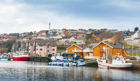 Fishing village, wooden houses and boats, Norway Stock Images